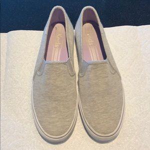 Light grey sneakers.